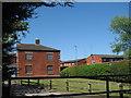 SJ4891 : Holt Farm by Sue Adair