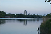 TQ2880 : View of the Hilton Hotel Park Lane reflected in the Serpentine in Hyde Park by Robert Lamb