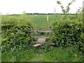 SK3822 : Double stile and footbridge by Graham Hogg