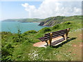 SX9354 : Bench with a view on the coast path by Roger Cornfoot