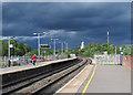 SP7487 : Market Harborough: sunlight and rainclouds by John Sutton