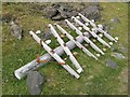 NM9459 : Fallen telegraph pole by Jonathan Wilkins