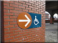 SJ8397 : Modern glazed brickwork, disabled parking sign by Bob Harvey