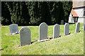 SE8960 : Gravestones at St Mary's, Fimber by Ian S