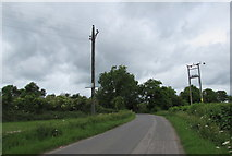 ST9898 : Wires over Tarlton Road north of Kemble by Jaggery