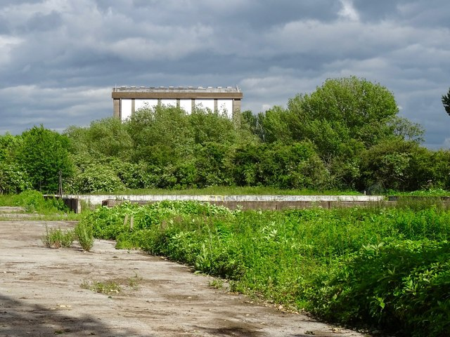 Former incinerator and derelict tennis court