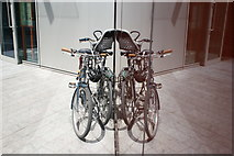 TQ2681 : View of a pair of bikes reflected in the spike of an office block in the Paddington Basin by Robert Lamb