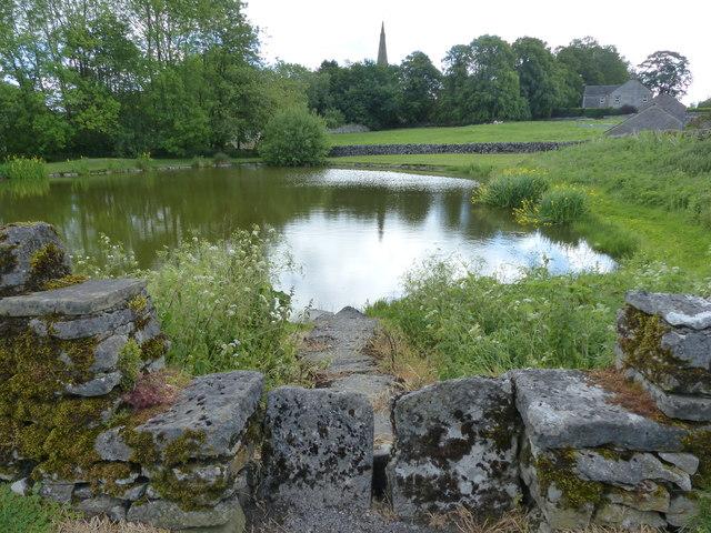 Monyash pond with stone stile