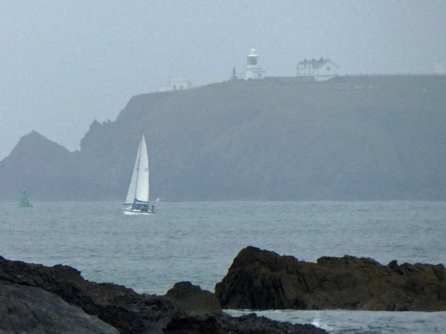 A hazy St. Ann's Head lighthouse from Angle