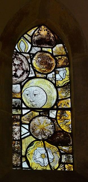 Chedworth, St. Andrew's Church: Fragments of c14th glass with a depiction of the moon