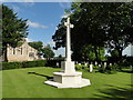 SK9479 : Cross of Sacrifice in Scampton churchyard by Adrian S Pye