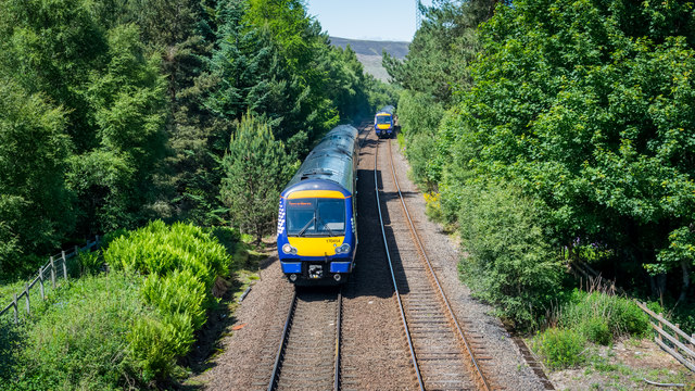 Class 170 DMUs crossing at Moy