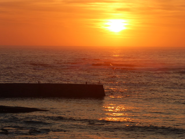 Sunset over the breakwater at Sennen Cove