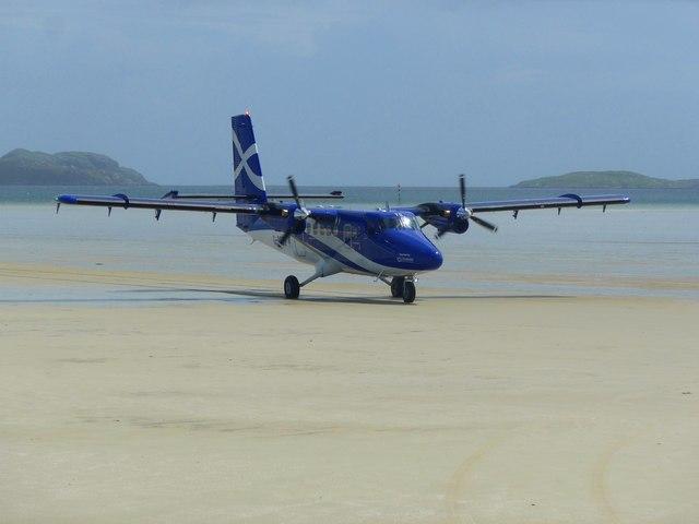 The Glasgow flight arrives at Traigh Mhor Airfield, Barra