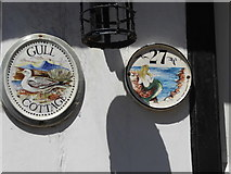 TQ9220 : House plaques in Rye by Marathon