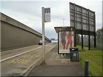 SJ9195 : Bus stop on Manchester Road North by Gerald England