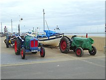 NZ6025 : Tractors and boats on Redcar seafront by Oliver Dixon