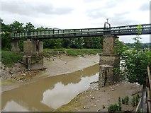 ST5772 : Swinging footbridge over the New Cut by John M