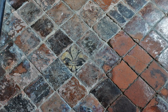 Buckland, St. Michael's Church: Well worn c15th tiles in the south aisle 2