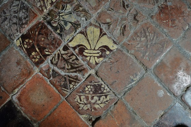Buckland, St. Michael's Church: Well worn c15th tiles in the south aisle 4