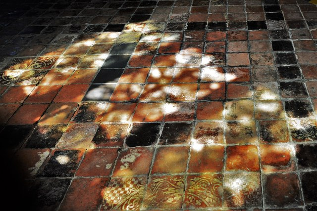 Buckland, St. Michael's Church: Well worn c15th tiles in the south aisle 5