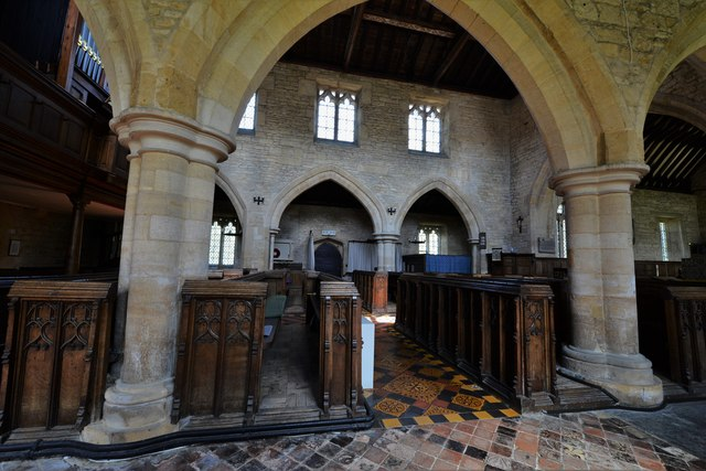 Buckland, St. Michael's Church: The south aisle with its well worn medieval tiles