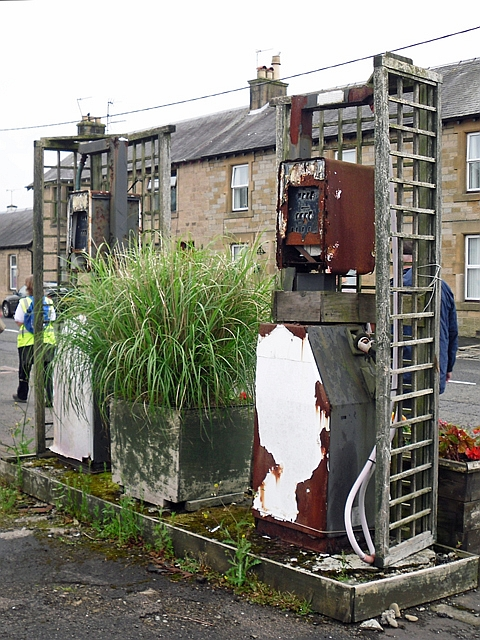 Old petrol pumps outside closed-down garage