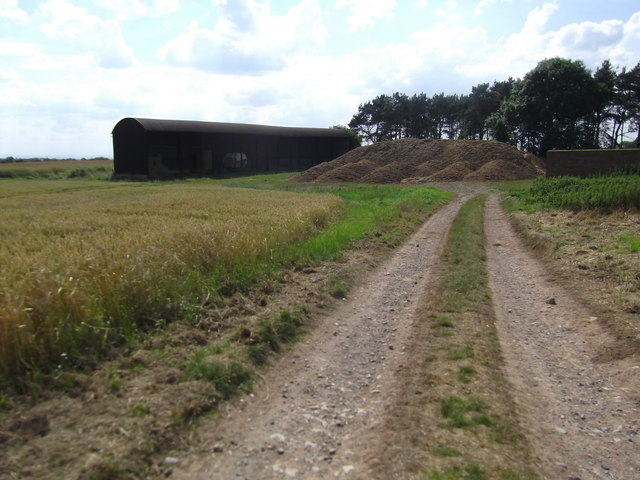 Black barn and a mound of silage