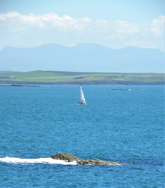 Sailing across Cymyran Bay