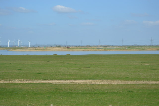 Field by flooded gravel pit