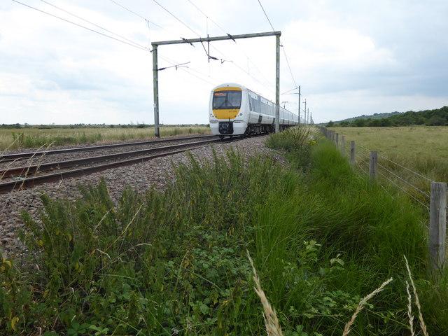 A C2C train approaching a foot crossing