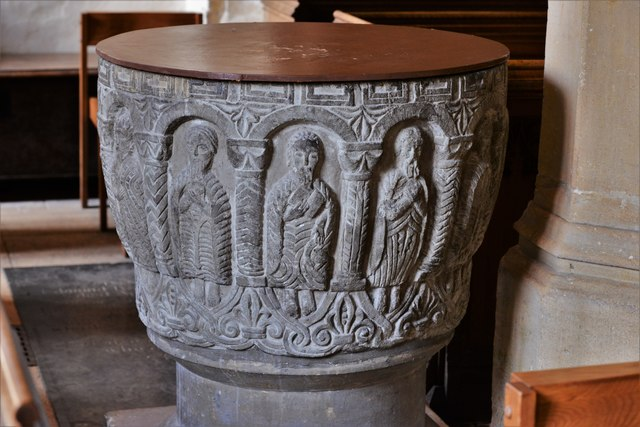 Rendcomb, St. Peter's Church: c12th Norman font, depicting eleven disciples with the tools of their trades 5