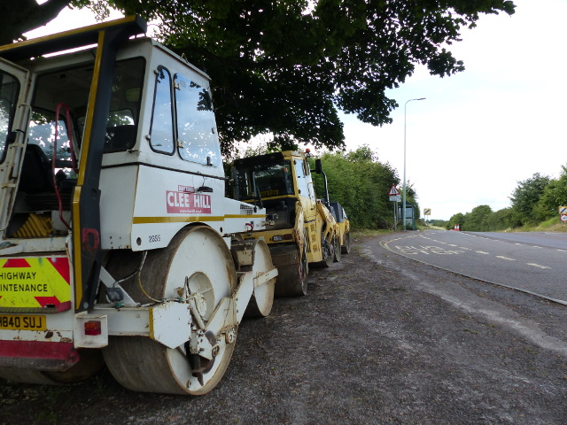 Road works vehicles at a bus stop on the A37, looking north