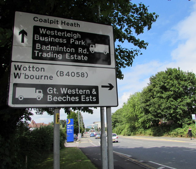 Black and white directions sign facing Badminton Road, Yate