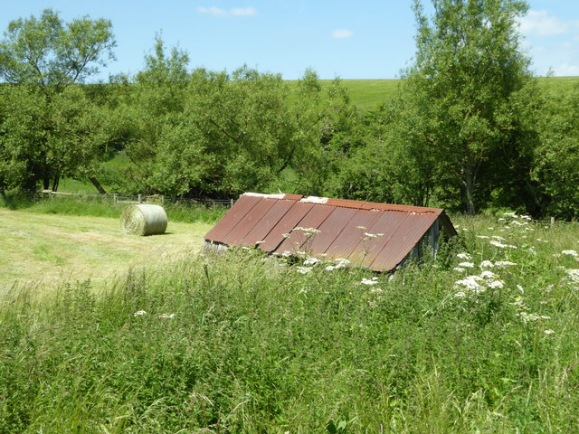 Hay bale and old shed