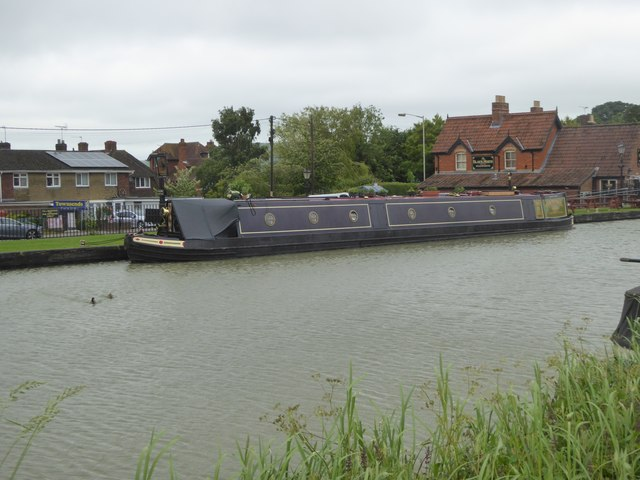 Canal narrow boat and the Black Horse inn