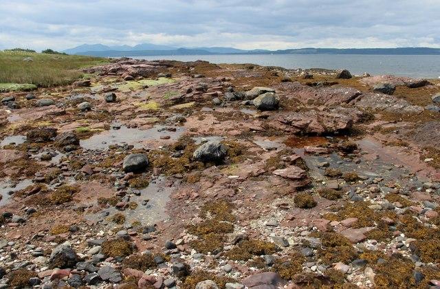 Intertidal rock and shingle near Stinking Bay