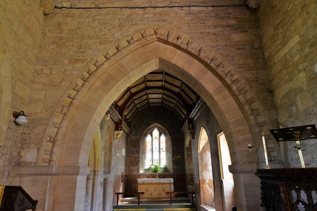 Asthall, St. Nicholas' Church: Single row of beakheads on the chancel arch 3