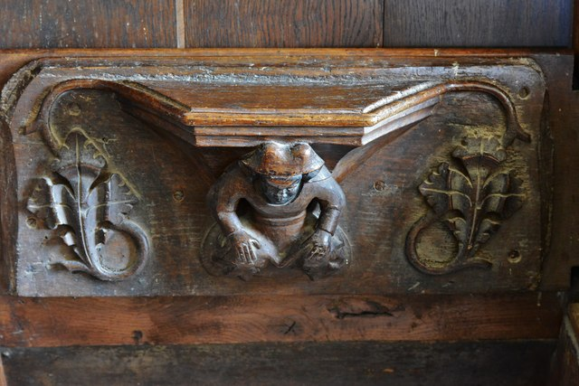 Swinbrook, St. Mary's Church: Medieval choir stall with misericord in the chancel 1
