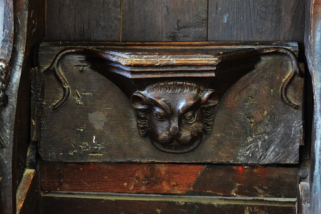 Swinbrook, St. Mary's Church: Medieval choir stall with misericord in the chancel 2