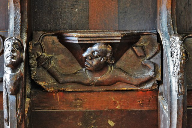 Swinbrook, St. Mary's Church: Medieval choir stall with misericord in the chancel 5