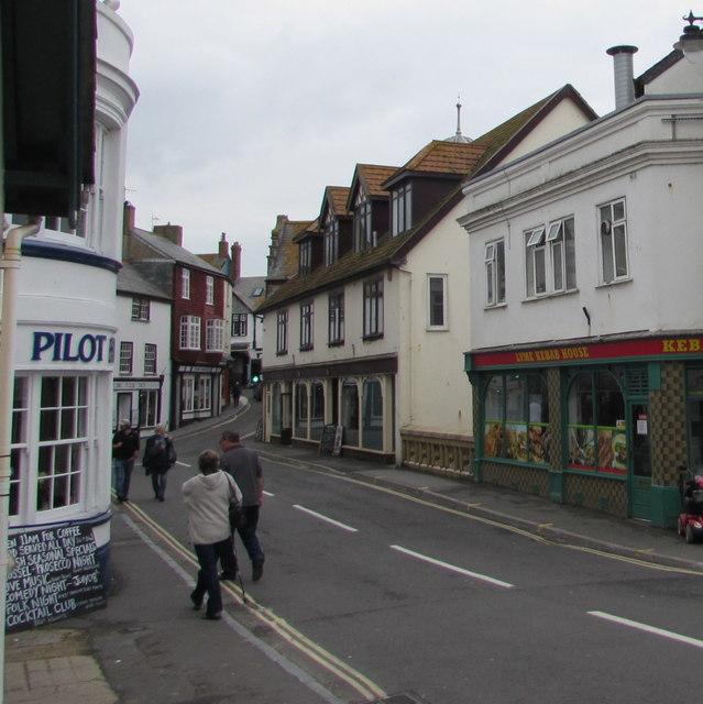 Walking along Bridge Street, Lyme Regis