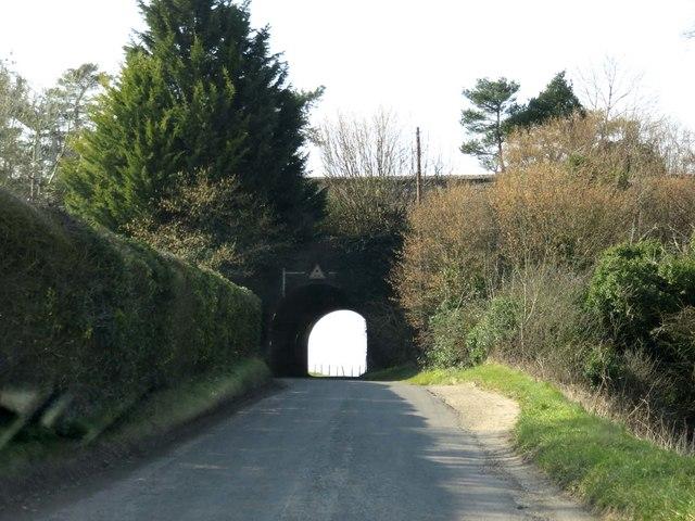 A rail bridge crosses a rural road neat Weston Colley
