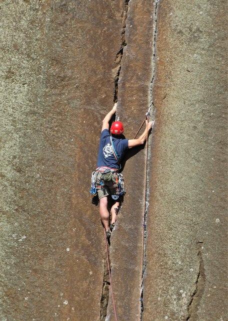Rock climber edging up The Embankment