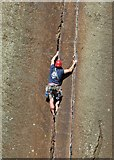 SK2480 : Rock climber edging up The Embankment by Neil Theasby