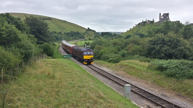 Wareham service approaching Norden Station and passing Corfe Castle