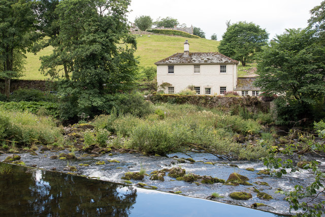House beyond weir on River Lowther