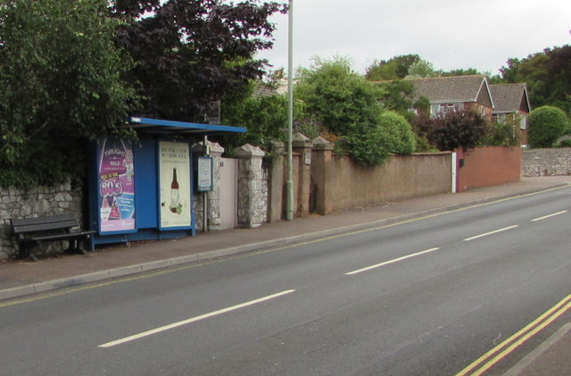 Adverts on a Salterton Road bus shelter, Exmouth