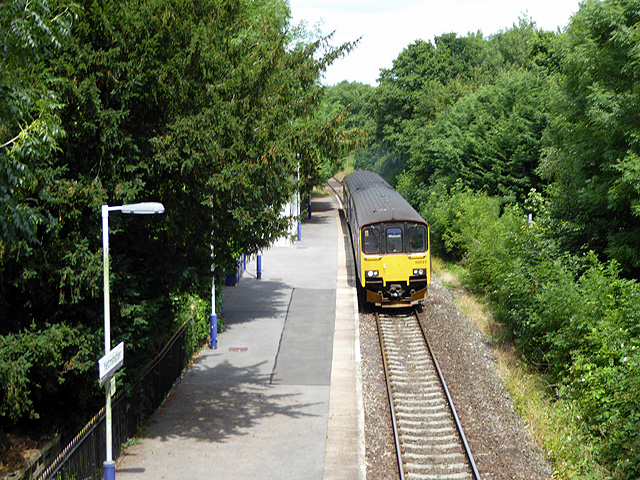 A train for Weymouth passing through Yetminster station
