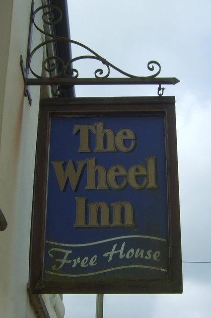 Sign for the Wheel Inn, Cross Lanes